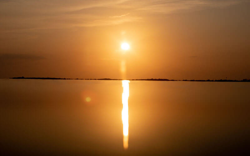An image of an amazing sunset over the Chesapeake Bay that is the featured image of the Chesapeake Sunset Cruises service.